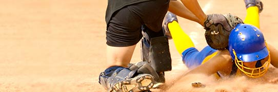 Woman sliding into home new mexico softball